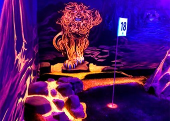 Fire lion in blacklight at adventure golf
